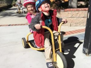 Cam and Abigail on trikes Raccoons
